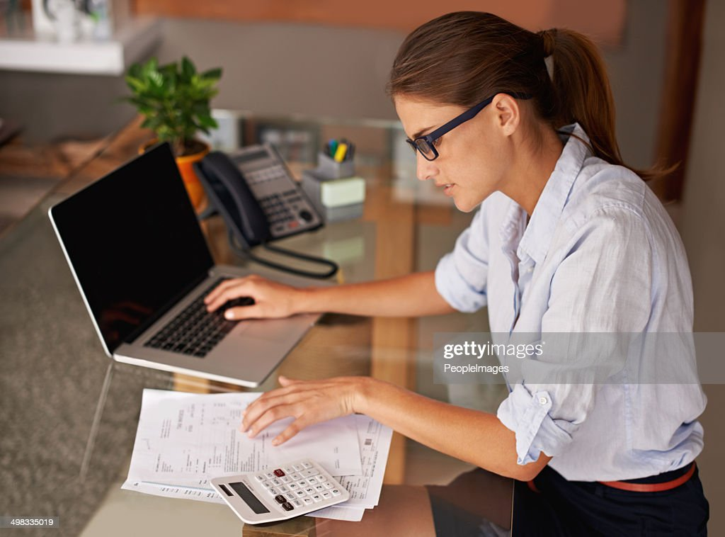 Doing her work at home : Stockfoto