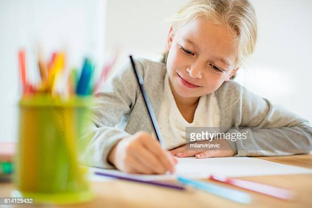 doing homework - schoolkinderen stockfoto's en -beelden