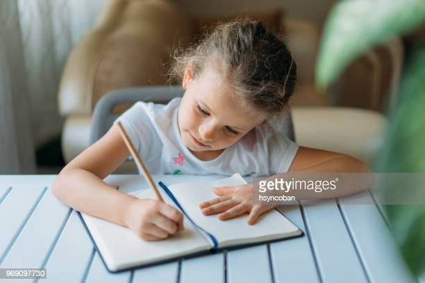 doing homework - correspondence stock pictures, royalty-free photos & images