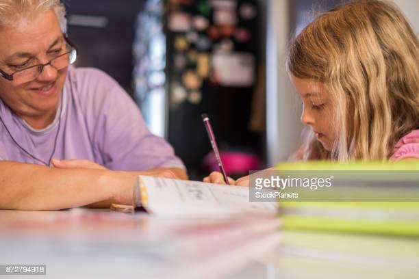 Doing homework with grandmother