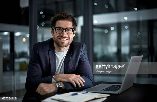 doing it for the love of success - man in office stock photos and pictures