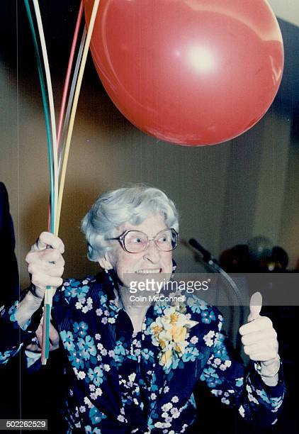 Doing Just fine Helen Malcolm flashes a smile and gives a thumbs up sign at a party to mark her 100th birthday yesterday at the Christie Gardens...