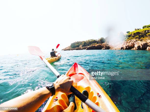 doing kayak from personal perspective with friend in the beautiful hidden corners of girona costa brava in spain during summer of 2020. - point of view stock pictures, royalty-free photos & images
