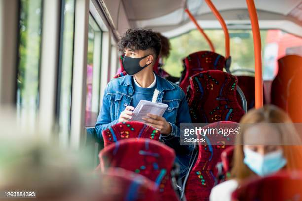 doing last minute homework - commuter stock pictures, royalty-free photos & images