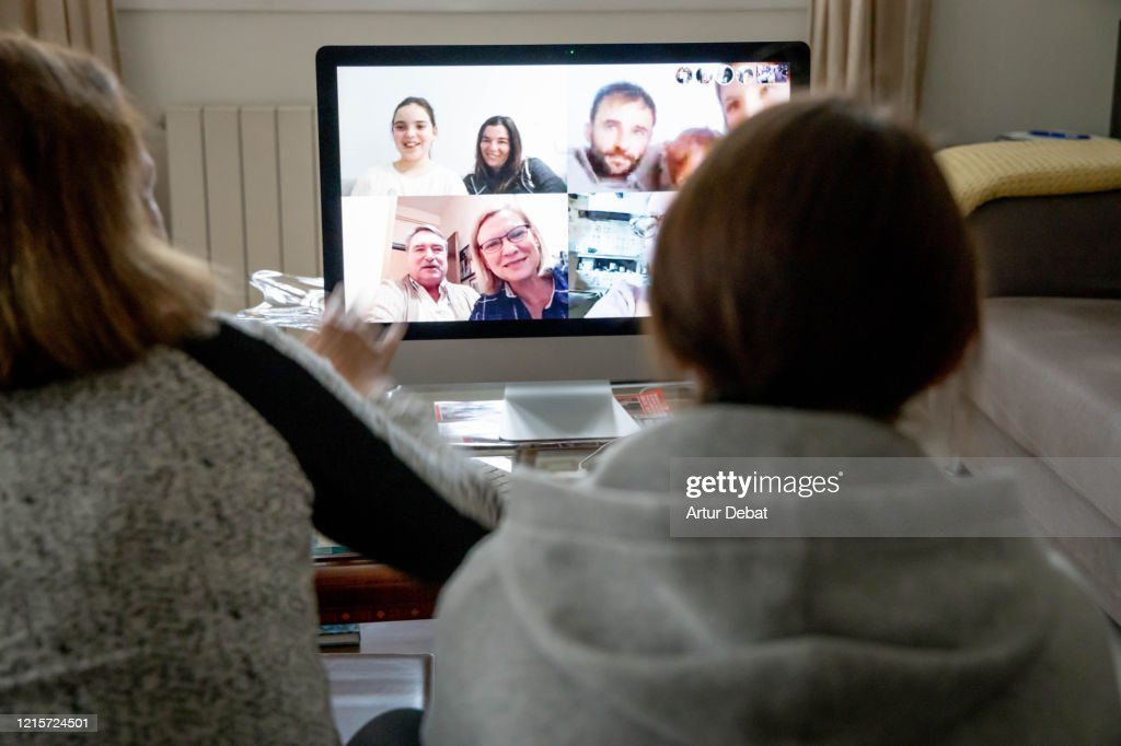 Doing multiple video call with family during home quarantine for the Coronavirus in Spain. COVID-19. : Stock Photo