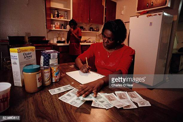 doing personal finance with food stamps - food stamps stock pictures, royalty-free photos & images