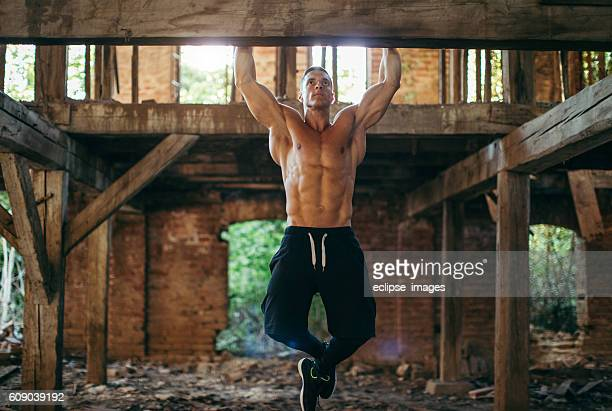 doing pull ups - chin ups stock photos and pictures