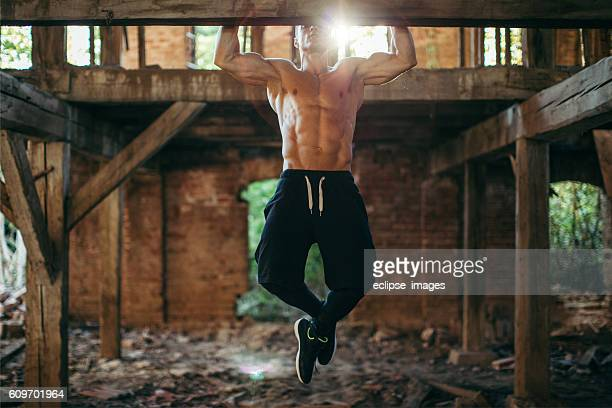 doing pull ups - handsome bodybuilders stock photos and pictures