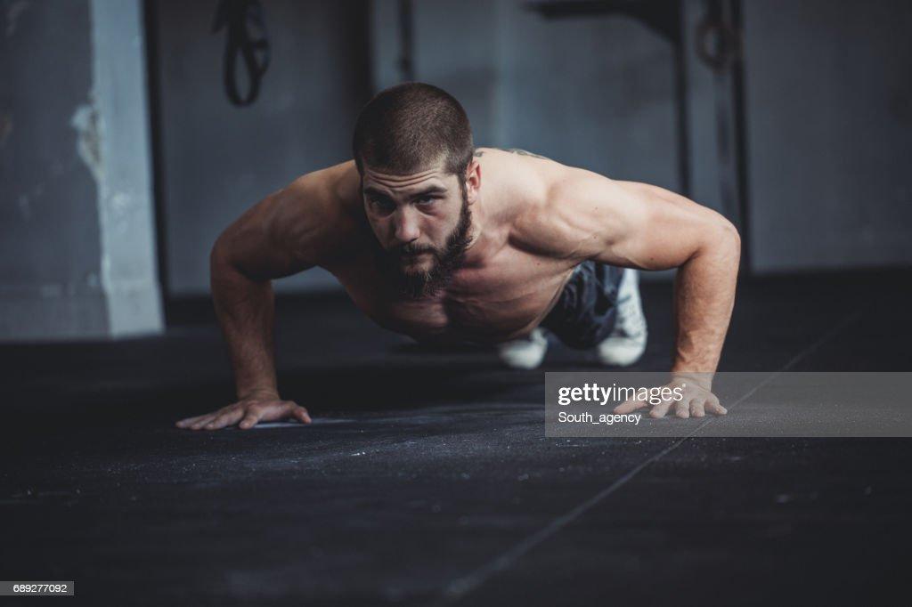 Doing push-ups : Stock Photo