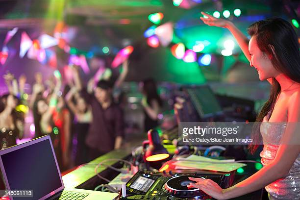 DJ doing record Scratching in nightclub