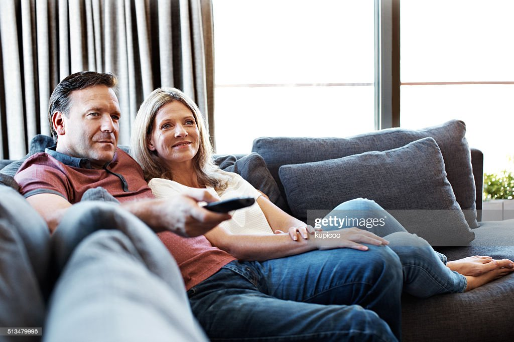 Doing some channel surfing : Stock Photo