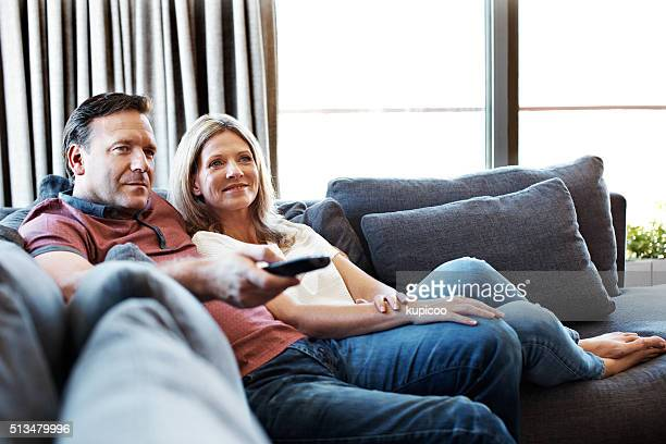 doing some channel surfing - adult film stock photos and pictures