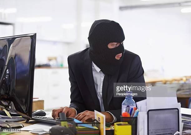 doing some illegal activities... - thief stock pictures, royalty-free photos & images