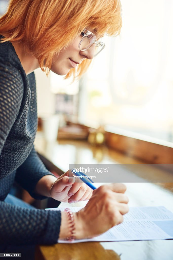 Doing some paperwork at the corner cafe : Stock Photo