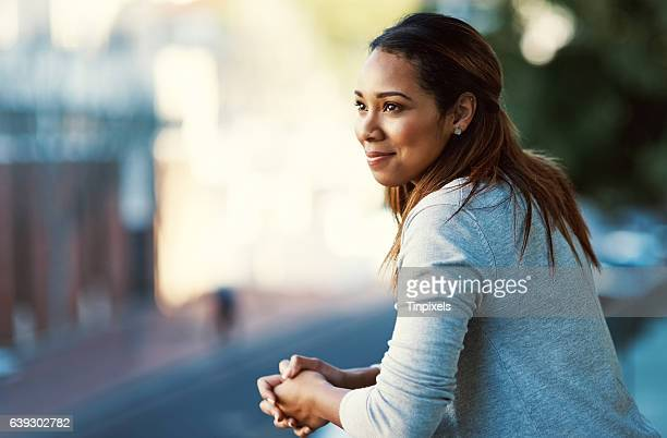 doing some thinking on the balcony - contented emotion stock pictures, royalty-free photos & images