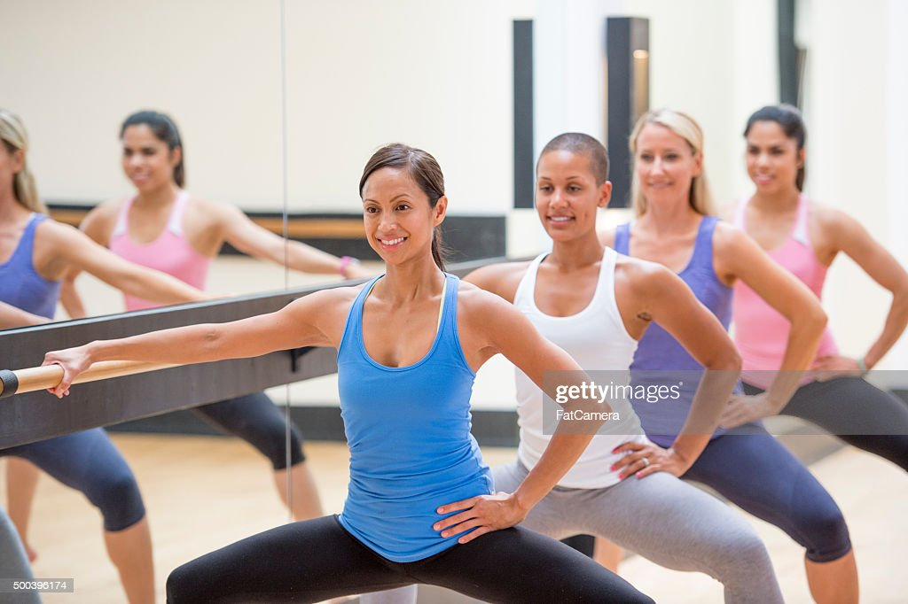 Doing Squats at Barre Class : Stock Photo