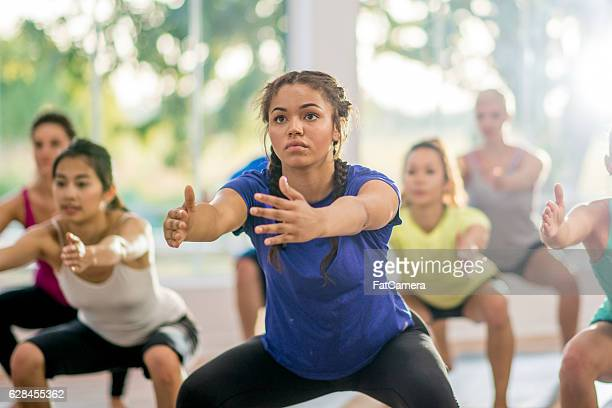 Doing Squats in a Fitness Class