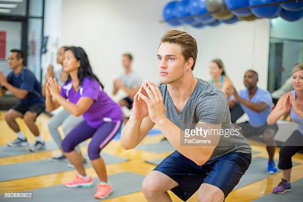 Doing Squats in an Exercise Class