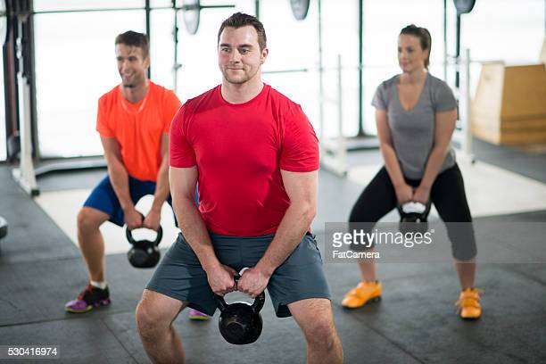 Doing Squats with Kettlebells