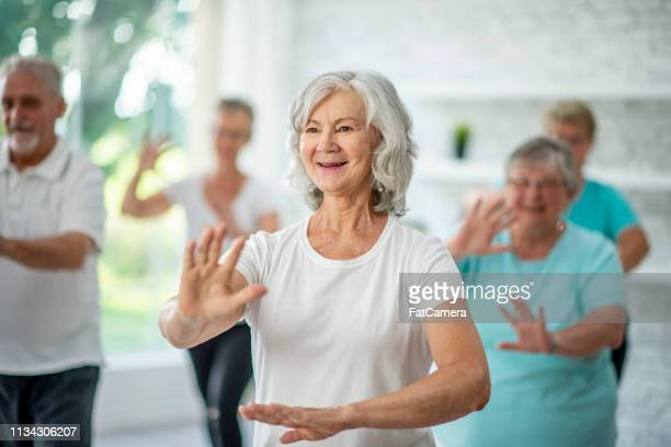 doing tai chi - senior adult stock pictures, royalty-free photos & images