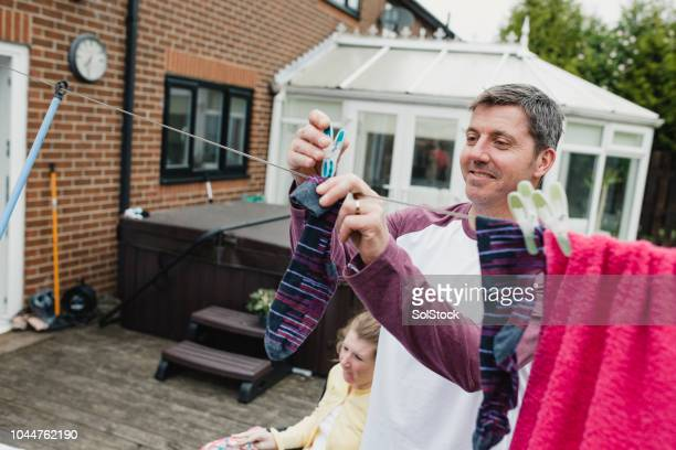 doing the chores at home with disabled daughter - learning disability stock pictures, royalty-free photos & images