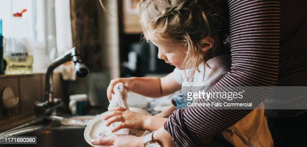 doing the dishes - lifestyles stock pictures, royalty-free photos & images