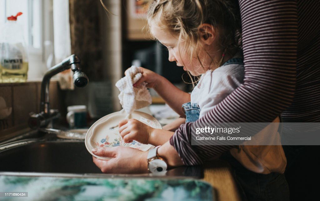 Doing the Dishes : Stockfoto
