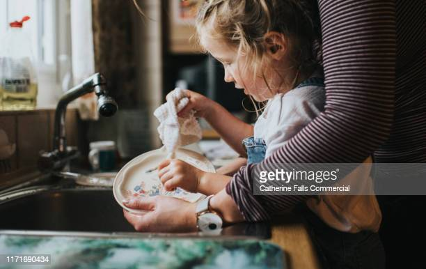 doing the dishes - water stock pictures, royalty-free photos & images