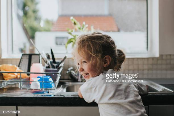 doing the dishes - chores stock pictures, royalty-free photos & images