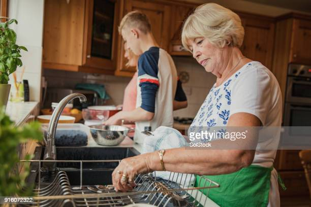 doing the dishes - chores stock photos and pictures