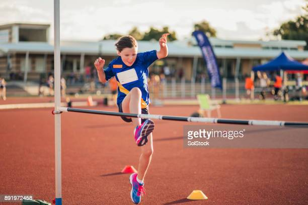 doing the high jump at athletics club - hurdling track event stock pictures, royalty-free photos & images