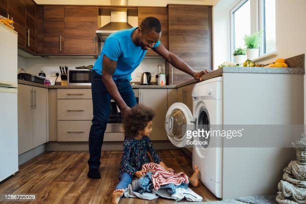 doing the washing - laundry stock pictures, royalty-free photos & images