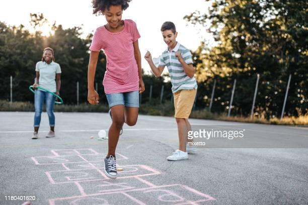 doing what kids do best, jumping for joy - giochi per bambini foto e immagini stock
