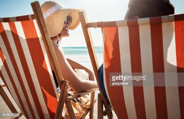 doing what summer lovers do - deck chair stock pictures, royalty-free photos & images