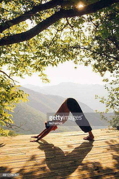 Doing yoga by the beautiful view