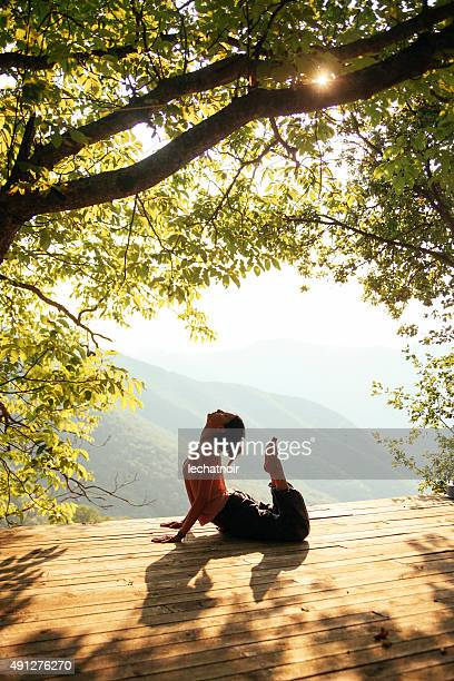 doing yoga by the beautiful view - terraced field stock pictures, royalty-free photos & images