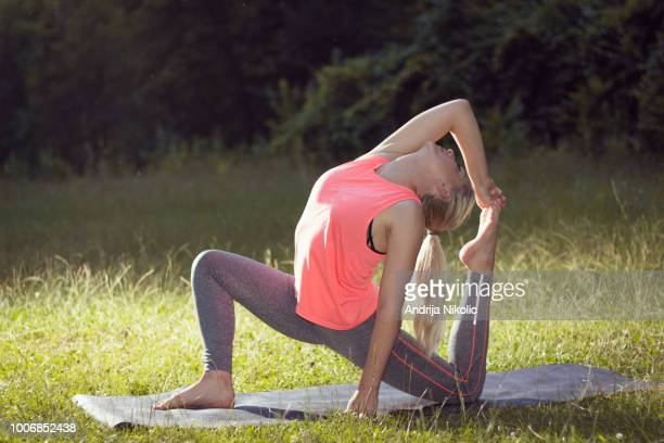 Doing yoga in nature to release the stress from everyday life