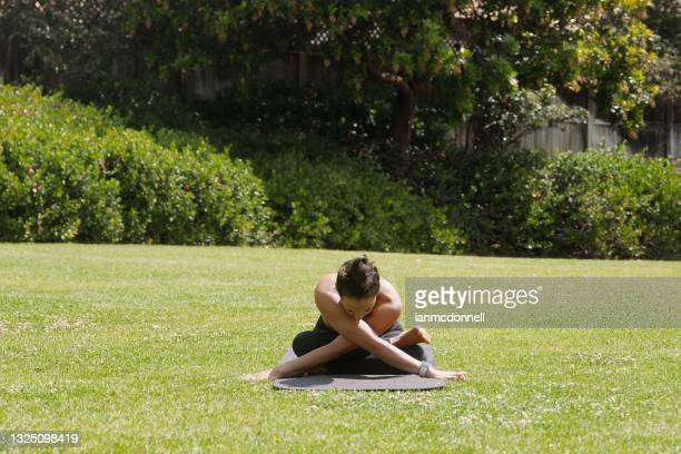 doing yoga - halter neck stock pictures, royalty-free photos & images