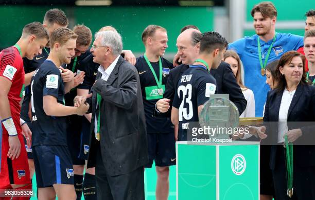 Doktor HansDieter Drewitz Vice President of German Football Association hands out the gold medal to winner Arne Maier of Berlin after winning 31 the...
