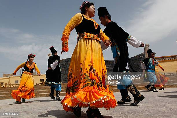 "Dolan Uyghur people perform Dolan Muqam dance on July 17, 2013 in Kashgar, China. The Xinjiang Uygur Autonomous Region, referred to as ""Xinjiang"", is..."