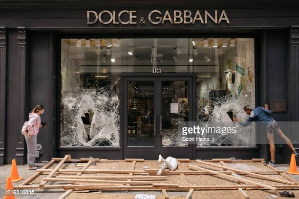 Dolce Gabbana storefront is shown heavily damaged after a night of largely peaceful protests descended into chaos and violent confrontations in lower...