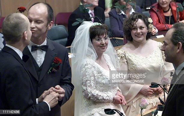 Dolf Pasker and Gert Kasteel kiss each other after getting married just after midnight by Amsterdam's mayor Job Cohen as Helene Faasen and Anne Marie...