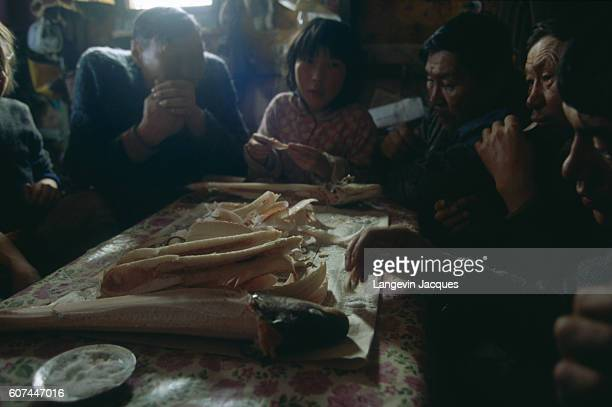 A Dolgan family enjoys a meal of reindeer meat The Dolgans traditionally a nomadic people who live along the Taymyr Peninsula in northern Siberia...