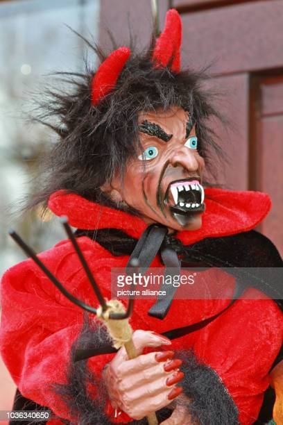 A doll depicting a devil is seen at a souvenir vendor's stall in Thale Germany 15 April 2015 Witches and devils will ply their dreadful trades in the...