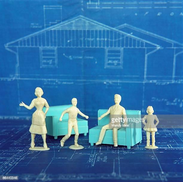 doll family with blueprint of house - rappresentazione umana foto e immagini stock