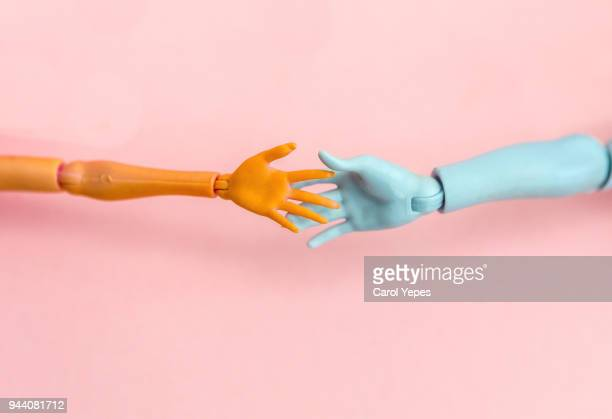 doll hands trying to touch each other