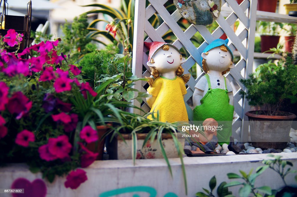 Doll In The Garden : Stock Photo
