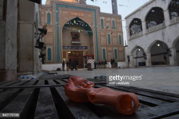 A doll lies on the ground the 13th century Muslim Sufi shrine of Lal Shahbaz Qalandar a day after a bomb attack in the town of Sehwan in Sindh...