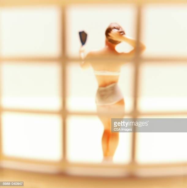 doll looking in hand mirror - lech stock photos and pictures