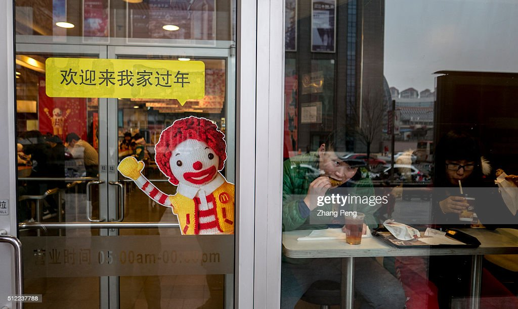 A Doll Of Ronald Mcdonald On The Glass Door Greets The Pictures